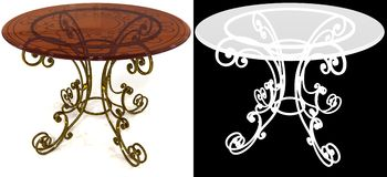 Wrought-iron a dining table with mask. Forged under the dining table painted old metal tabletop with glass rod translucent brown Royalty Free Stock Photography