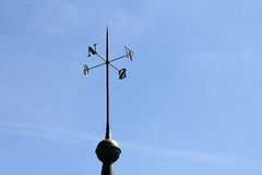 Wrought iron display of directions on a tower Royalty Free Stock Image