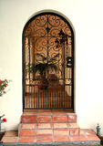 Wrought Iron Door. Beautiful wrought iron door at the entrance of a patio royalty free stock image