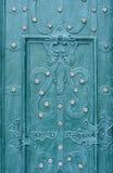 Wrought iron door background green Stock Images