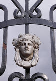 Wrought Iron Door with female head Royalty Free Stock Photo