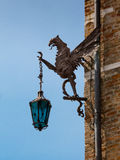 Wrought Iron Dragon with Lantern, decoration on brick wall Stock Image