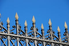 Wrought iron fence. Close-up of a wrought iron fence over a blue sky Royalty Free Stock Image