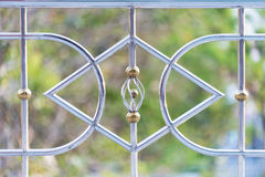 Wrought iron fence. Blurred background Royalty Free Stock Images