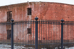 Wrought iron fence and brick facade Stock Photo