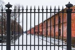 Wrought iron fence and brick facade Stock Photos