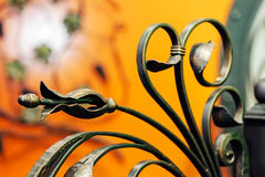 Wrought iron fence. Details, structure and ornaments of wrought iron fence with gate Royalty Free Stock Photo