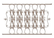 Wrought iron fence and gate detailed on isolated white background. Royalty Free Stock Image