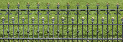 Wrought Iron Fence with Gold Stars Royalty Free Stock Photos