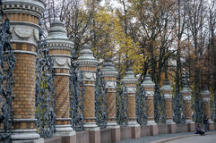 Wrought Iron Fence and park. Stock Photo