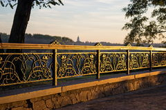 Wrought iron fencing with mythical creature. General view of decorative lattice in shape of Simargl, mythical creature, winged lion or dog. Photo taken in Royalty Free Stock Photo