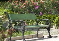 Wrought iron garden bench Stock Photo