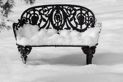 Wrought Iron Garden Bench in the Snow Royalty Free Stock Images