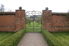 Wrought iron garden gate with gate posts Stock Image
