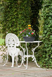 Wrought Iron Garden Table And Chair Stock Photo