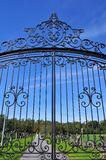 Wrought iron gate. Seen close under blue sky royalty free stock photos