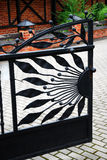 Wrought iron gate. An image of an  open decorated wrought iron gate Royalty Free Stock Photo