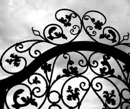 Wrought Iron Gate. Seen against a dramatic sky Stock Image