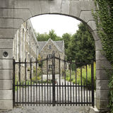 Wrought iron gate in abbey garden Royalty Free Stock Image