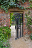 Wrought iron gate in garden Stock Photo