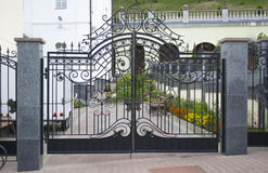 Wrought-iron gate in graveyard. Background Royalty Free Stock Photography