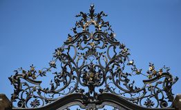 Wrought Iron Gate Ornament. And blue sky Stock Photography