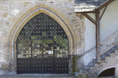 Wrought iron gate in Ostrog castle. Wrought iron entrance gate to the castle of Ostrog Royalty Free Stock Photo