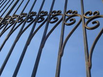 Wrought iron gate pattern. Classical spiral embellishments of a wrought iron gate Royalty Free Stock Images