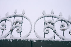Wrought-iron gate in the snow Royalty Free Stock Image