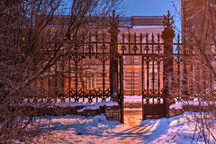 Wrought iron gate in winter scene, HDR. Wrought iron gate and bushes in the night winter scene, HDR Royalty Free Stock Image