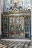 Wrought iron gates with images of saints and angels in Basilica di San Giovanni in Laterano in Rome, capital of Italy. Wrought iron gates with images of saints royalty free stock images