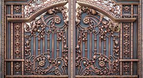 Wrought-iron gates, ornamental forging, forged elements close-up.  Royalty Free Stock Images