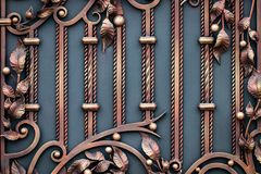 Wrought-iron gates, ornamental forging, forged elements close-up.  Stock Photography