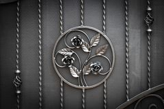 Wrought-iron gates, ornamental forging, forged elements close-up.  royalty free stock photography