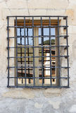 Wrought iron grille window Stock Images