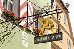 Wrought iron hanging sign in Rothenburg ob der Tauber, Germany. Royalty Free Stock Images