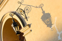 Wrought-iron lantern  casts a shadow on a wall Royalty Free Stock Image