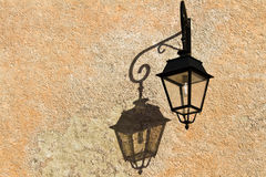 Wrought-iron lantern with its shadow on the yellow wall Royalty Free Stock Images