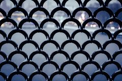 wrought iron lattice on the bridge over the river in the evening city royalty free stock photos