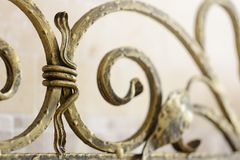 Wrought iron ornamental grate for the fireplace. Decorative detail of metal lattice for interior. stock photography