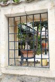 Wrought iron railing in the window. Royalty Free Stock Photos