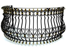 Wrought-iron railings for a round balcony in black decorated with gold inserts isolated on white. 3d render. Wrought-iron railings for a round balcony in black Royalty Free Stock Photo
