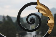 Wrought Iron Scrolled Gate of Estate. Wrought Iron Scrolled Gate with Gold leaf detail on gate of estate in Wicklow, Ireland Royalty Free Stock Image
