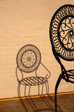 Wrought Iron Silhouette. Shadow or silhouette of an ormental wrought iron chair stock photos