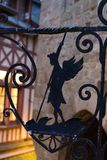 Wrought iron silhouetted winged figure holding spear european medieval royalty free stock photos