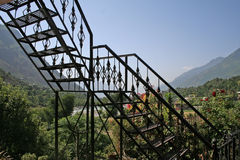 Wrought iron steps in mountain home. Wrought iron ladder to terrace in mountain home Stock Images