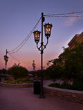 Wrought Iron Street Lanterns and Light Strings Stock Photo