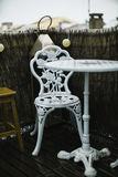 Wrought-iron table and chair. On the balcony royalty free stock images