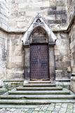 Wrought iron vintage door and stone steps of the church. Stock Photography