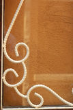 Wrought iron white on cement wall. Royalty Free Stock Image